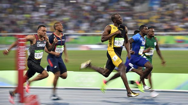 Usain Bolt Makes History Winning His Third Consecutive Gold Medal in the Men's 100m Final