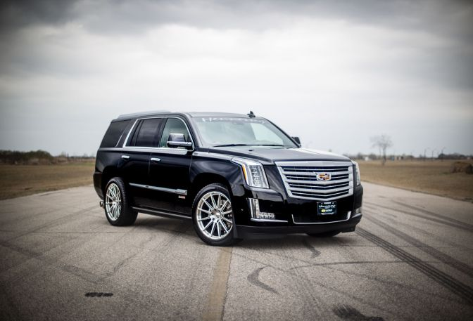 WATCH THIS 800-HP HENNESSEY ESCALADE SMOKE A CAMARO ZL1 IN A DRAG RACE