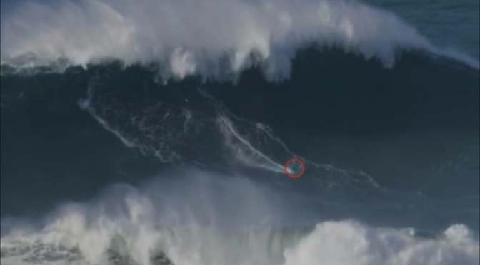 WATCH SURFER 'SET NEW WORLD RECORD' BY RIDING 100-FOOT MONSTER WAVE